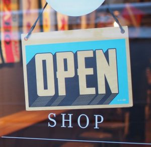 open sign in store glass door points to post Entrepreneurs Wanted
